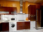 Kitchen with oven, washing machine, tumble dryer and all the main utensils for self-catering.