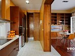 The kitchen can be separated from the living area by large sliding doors.