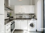 Kitchen equipped with all main utensils and appliances. With oven and washing machine.