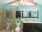 Beautifully updated bathroom with tiled shower and double vanity