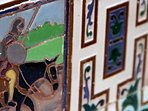 Original ceramic tiles show scenes from the story of Don Quixote.