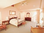 Sunny GardenView room has King Bed. Shares full bath and two sinks with adjacent Balcony Room.