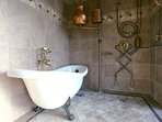 Master Suite's bathtub and shower complex offers five ways to get wet!