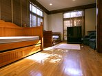 Kids room sleeps four in two trundle beds. Half-bath