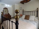The bedroom with comfortable bed, wardrobe, dressing table, bedside tables and chair
