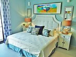 The master suite calms with restful serenity as the remote control A/C cools you