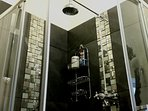 With large revitalizing waterfall shower.