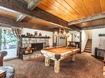 Game room with pool table and split stone granite fireplace