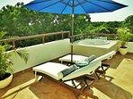 Doze or sunbathe in the restful loungers with tree tops swaying in warm gentle breezes