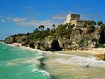 Acres of ruins sit cliff-top above the shores of Tulum beach with unparalleled views