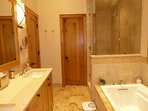 master bedroom bathroom with soaker tub and shower
