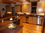 gourmet kitchen with top quality appliances and lots of bench and storage