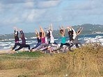 Yoga on the beach, early in the mornig.