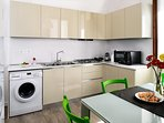 The kitchen is fully provided with gas cooking top, double-basin sink,  cooker