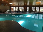 Indoor pool and hot tub in main building.