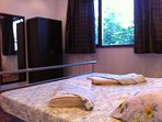 Bedroom with double bed 1.80m x 2.00m, wardrobe, large mirror