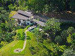 to Lattice House, surrounded by jungle, facing the coastline below.
