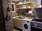 Kitchen: oven, gas stove, large refrigerator, microwave, coffee maker, toaster.