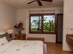 Bedroom 3 (queen). Both bedrooms have ensuite vanities with copper sinks and ocean views.