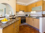 Well equipped kitchen with direct access from entrance terrace.
