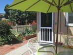 Garden patio with avocado tree, fig tree, raised-bed vegetables, etc.