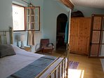 Bedroom 1 - king size brass bed with en suite bathroom. Views over hills and towards medieval church