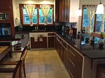 Kitchen with galaxy black granit counter