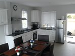 fully equipped kitchen and dining table for 6