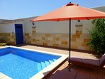 Large parasol gives a shady break from the sun whilst relaxingpoolside outdoors.
