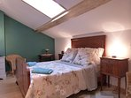Master bedroom, which has a low single bed tucked under the eaves