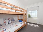 1st floor, bunk bed room, with sea views.