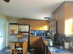 Bright kitchen and island with wine rack storage. Large pantry.