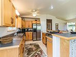 Full Kitchen with refrigerator, stove, blender, coffee maker and