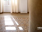 Traditional floor tiles and marble columns.