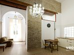 Features include exposed brick walls, traditional floor tiles, marble columns and high ceilings.
