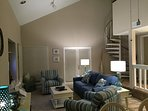 Living Room - Spiral Staircase to semi-private loft area. Door to balcony