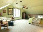 Queen bed in Leopard Room, East Wing