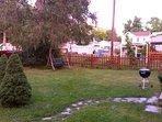 Area view.  Outside garden swing