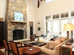 The Beautiful Living Room, with 25 Foot Vaulted Ceilings and Stunning Fireplace