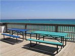 Picnic tables on the observation deck on the beach