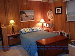 guest cottage bedroom with full bed and full size futon; table and chairs and seating area