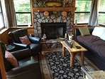 Den with stone wood burning fireplace, sleeper couch