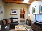 Authentic viga ceilings, large flat screen Sling TV and the beginning of tasteful art throughout
