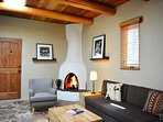 Wood burning kiva fireplace, slate floors, tall ceilings, light and bright ambiance