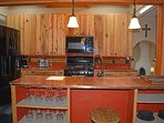 Counter overlooking pulman style kitchen with dramatic copper counter tops