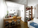 The kitchen is partially separated from the living room by a breakfast bar, includes 2 bar stools