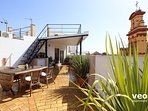 Lower terrace with 40sqm decorated with plants and garden furniture.