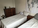 Guest bedroom with 2 XL twin beds
