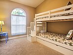 A twin-over-twin bunk bed with trundle can accommodate 3 guests.
