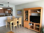 Living room with dinning table and flat HDTV
